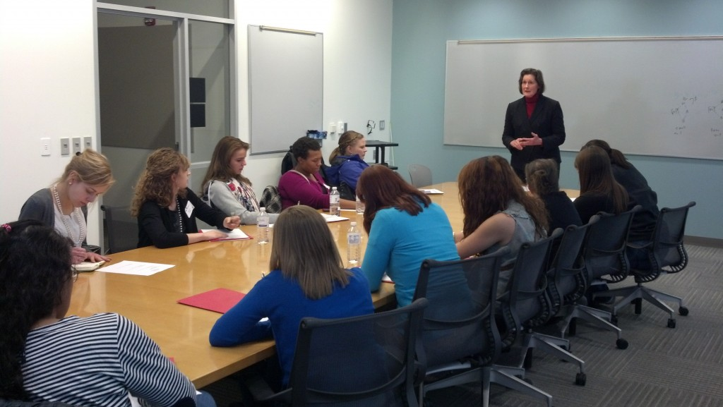 "Elizabeth ""Betsy"" Hoffman, professor of economics, presents on negotiations during a break-out session."