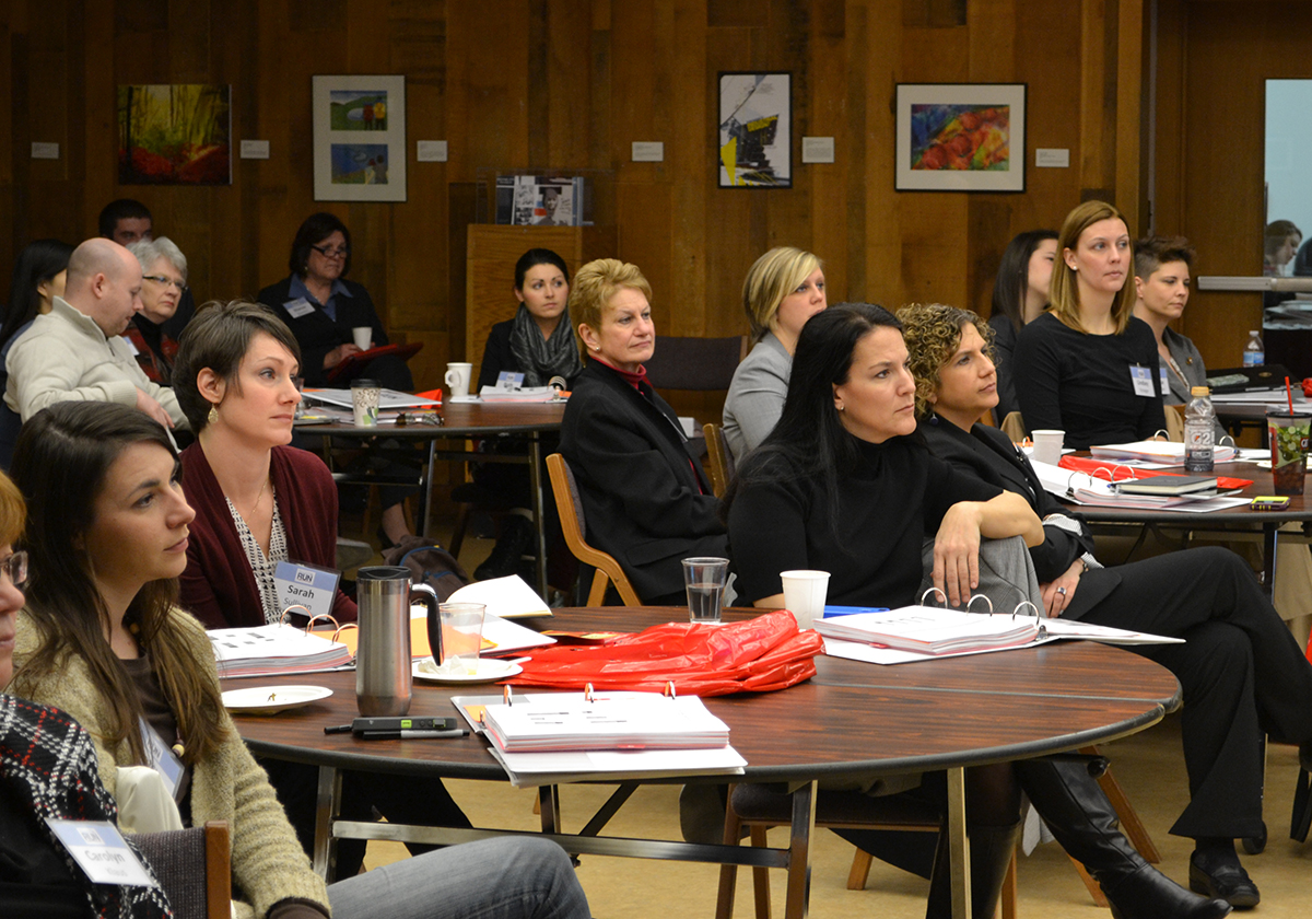 "Participants attending the workshop on ""Introduction to Iowa Politics and Political Parties"" listen to statistics about women in local, state and national elected office."