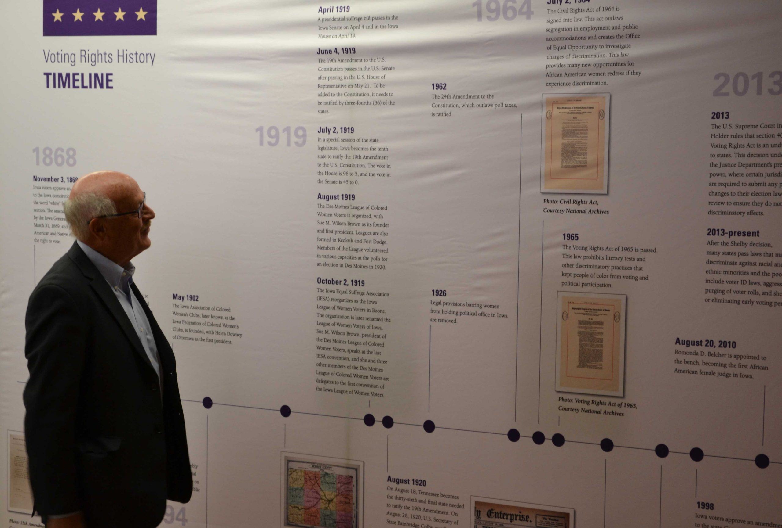 Visitor at the Feb. 14 kickoff reading the timeline in the 'Toward a Universal Suffrage' display