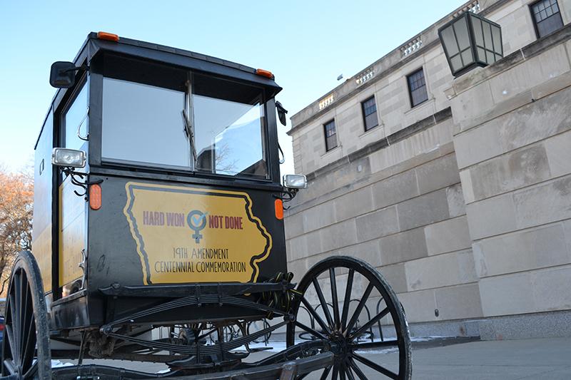Replica suffrage wagon parked outside the Memorial Union.