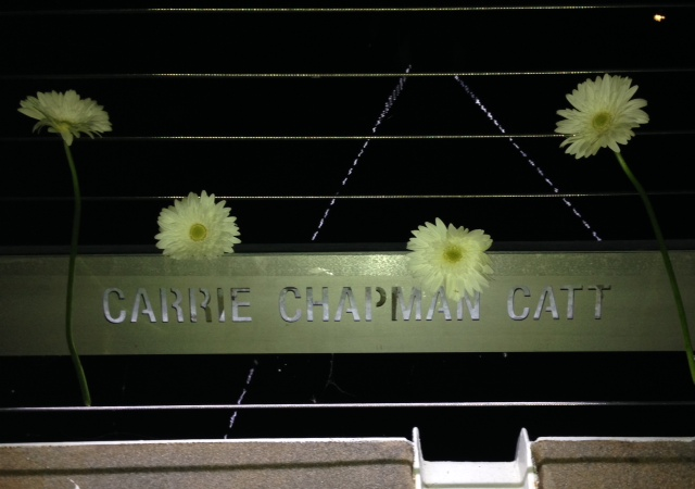 Daisies were handed out during the dedication ceremony. Bystrom and others in support of Catt decorated her nameplate before tossing them into the Des Moines River.
