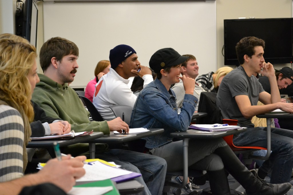 Students in LAS 322 listen for instructions for the day