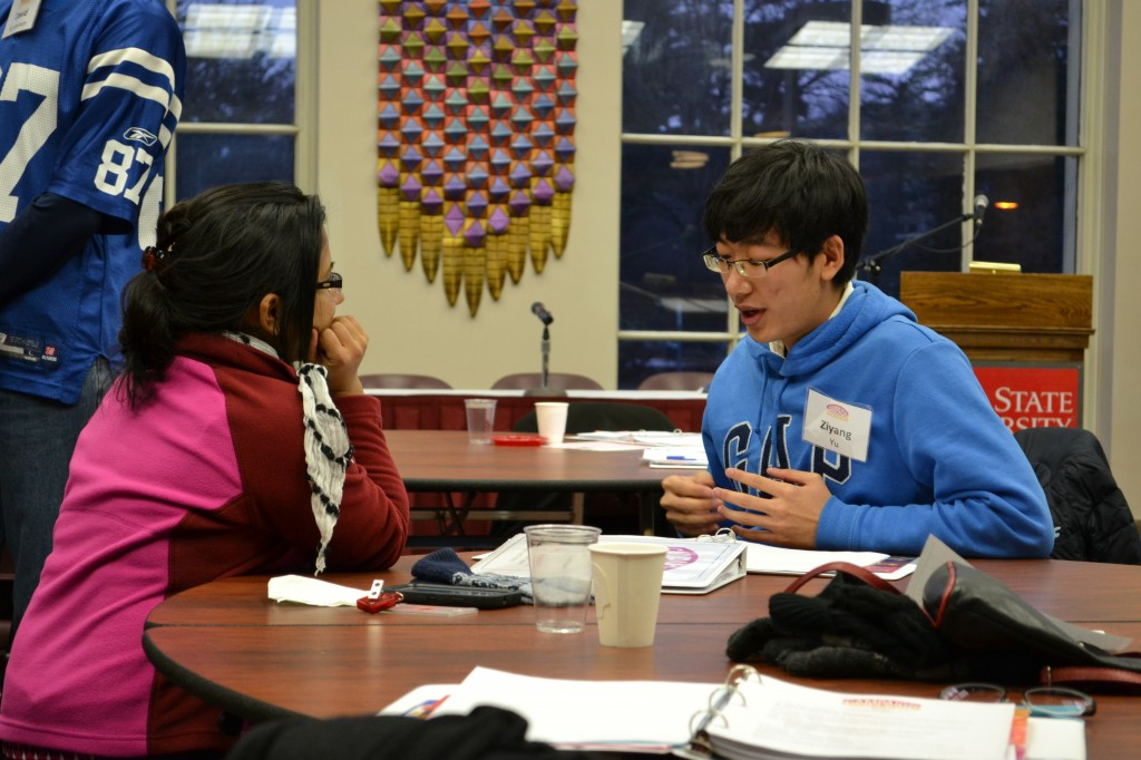 Luna Kc (left) and Ziyang Yu discuss campaign issues and strategies.