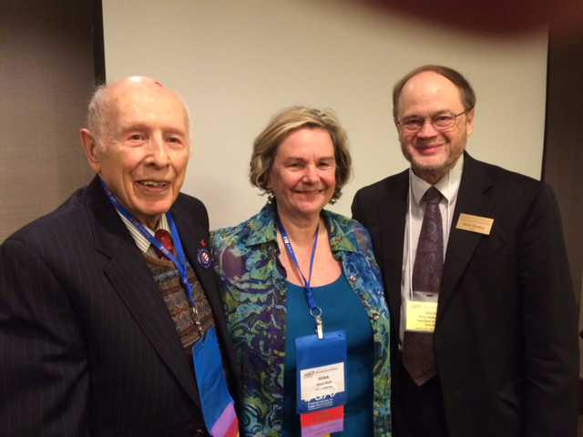 Dwight Ink (left), Dona Wolf and Mack Shelley, chair of the Iowa State department of political science, pose during the ASPA panel.