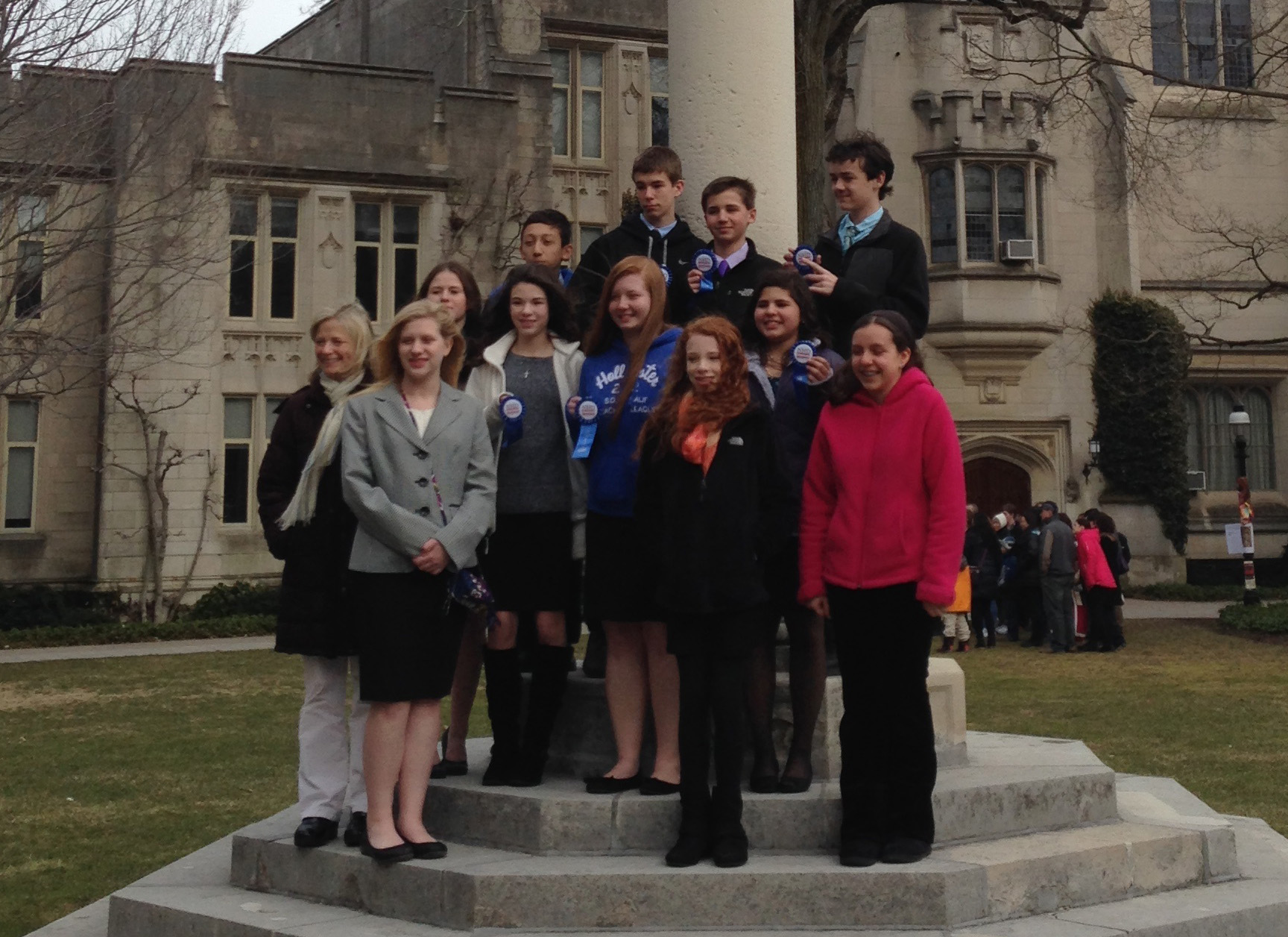 Emma Anmolsingh (pink jacket, far right) poses with her classmates after regionals at Princeton University.