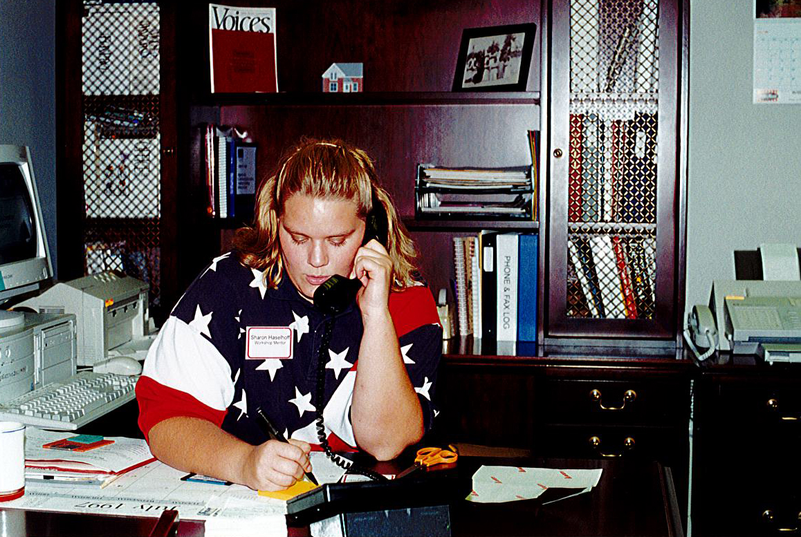 Sharon Haselhoff answering the phone in July 1997 at the Catt Center.