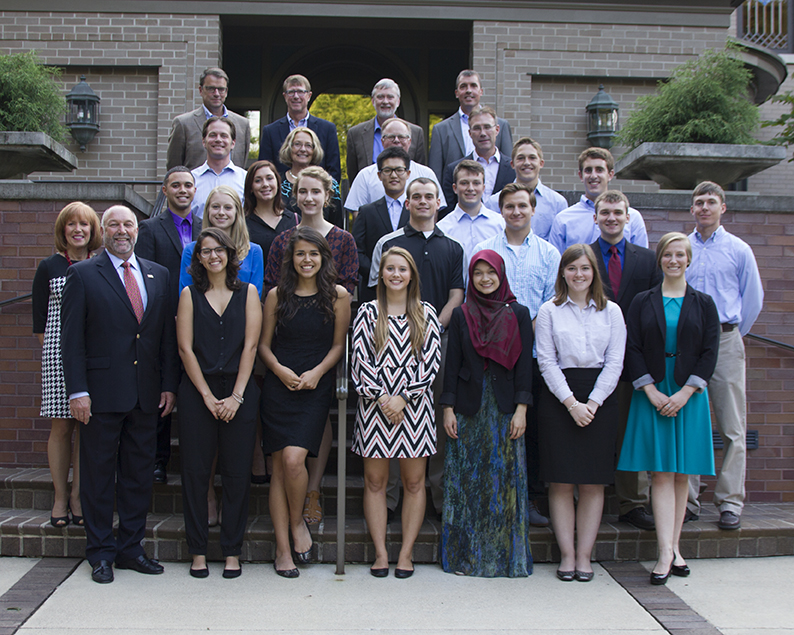 Vermeer International Leadership Program students pose at The Knoll with President Steven and Janet Leath and members of the Vermeer senior leadership team on Aug. 27.