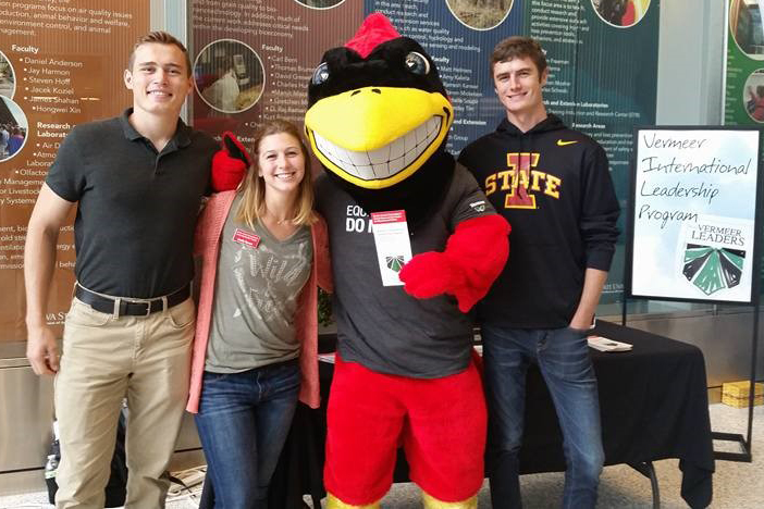 Cy poses with 2016-17 cohort members Forrest Beeler (left) and David Schemm and VILP intern Emily Ramm at Vermeer Equipment Day.