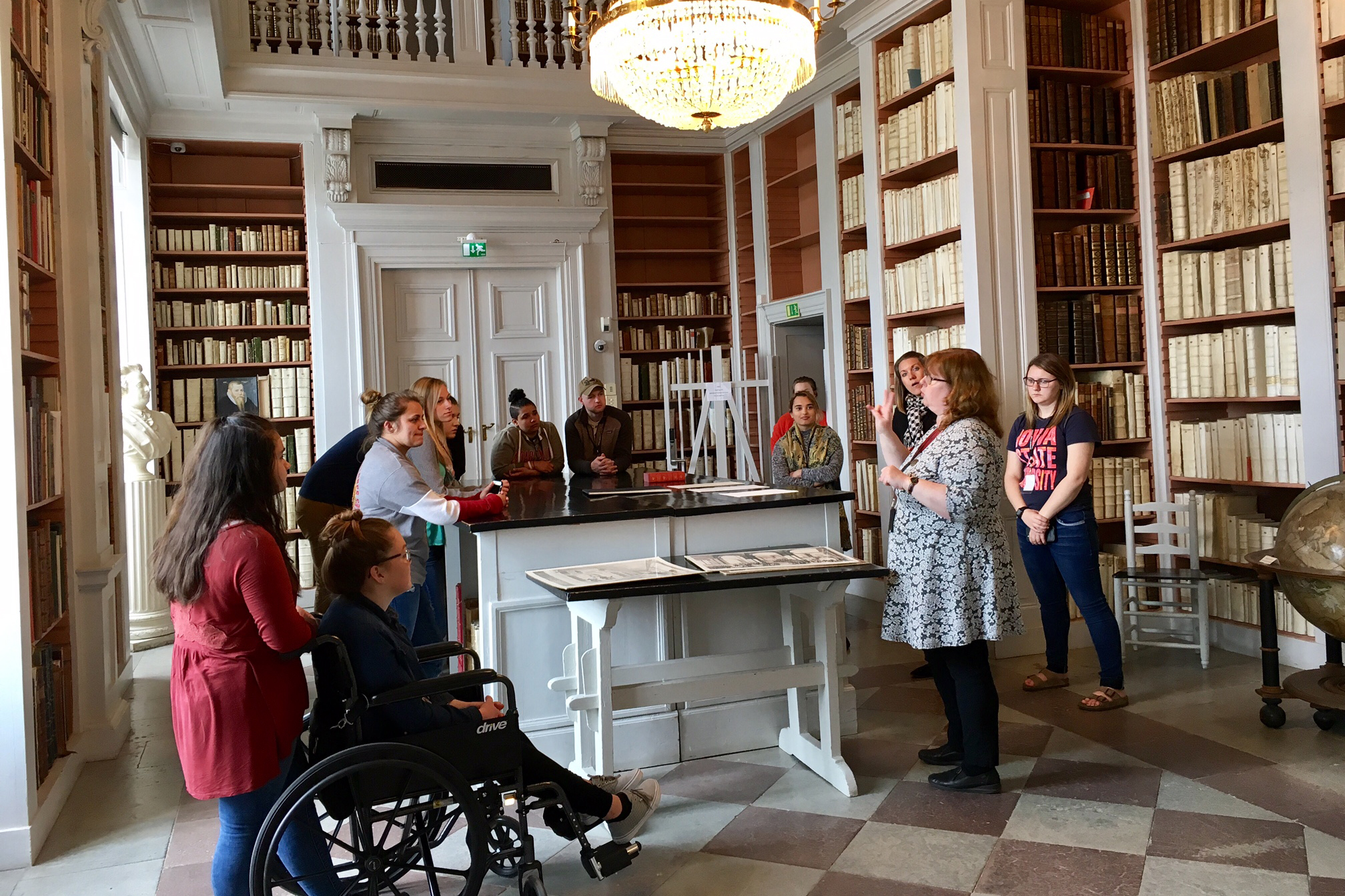 "Students viewed a first edition of ""The Adventures of Huckleberry Finn"" and an original letter from Samuel Clemens during their tour of the Uppsala University Library."