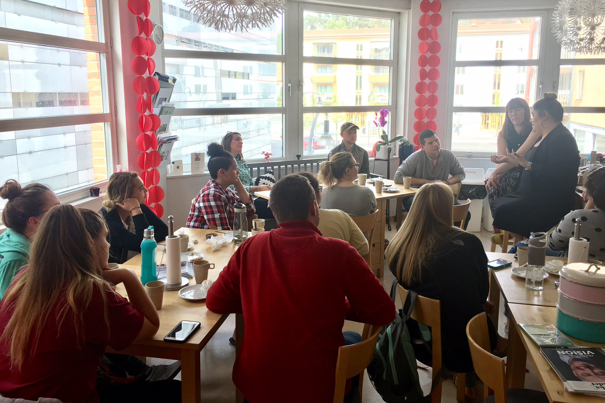 "Students enjoy ""fika"" while meeting with our service partners from Individuell Människohjälp, an organization that assists refugees in Sweden."