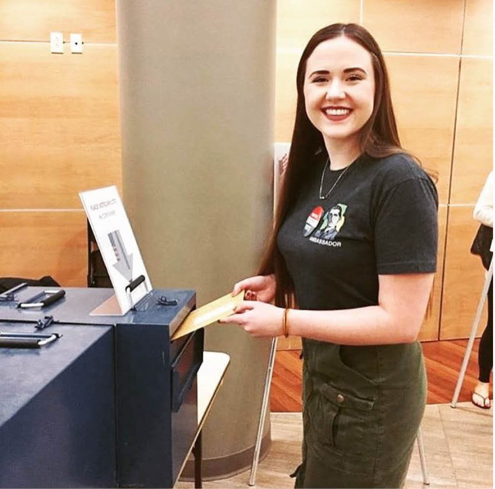 Olivia Anderson, a senior at Simpson College and an Andrew Goodman Foundation ambassador, casts her vote early on Oct. 25 to encourage other students to remember to vote. (https://andrewgoodman.org)