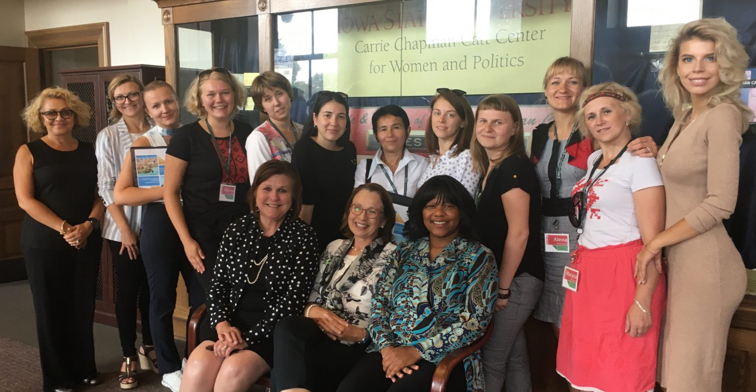 Catt Center director Dianne Bystrom (seated left) and Ready to Run Iowa participants Victoria Szopinski and Monic Behnken met with 10 women leaders from Belarus and their two interpreters on Sept. 14 at the Catt Center.