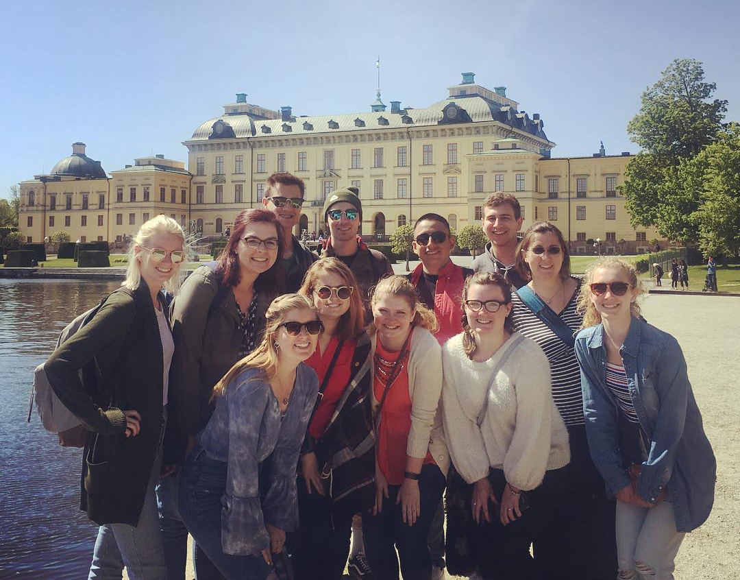 Widner (far right) and the students enjoyed a boat ride to Drottningholm Palace on the 2018 trip.