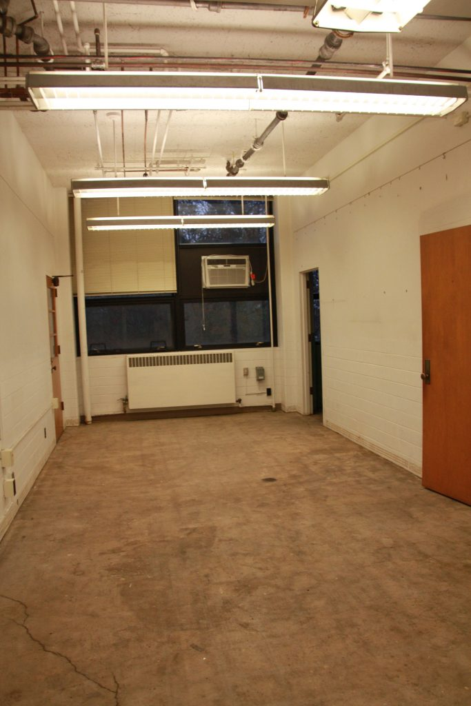 Office with carpet removed. Underlying tile with asbestos taken out with abatement.