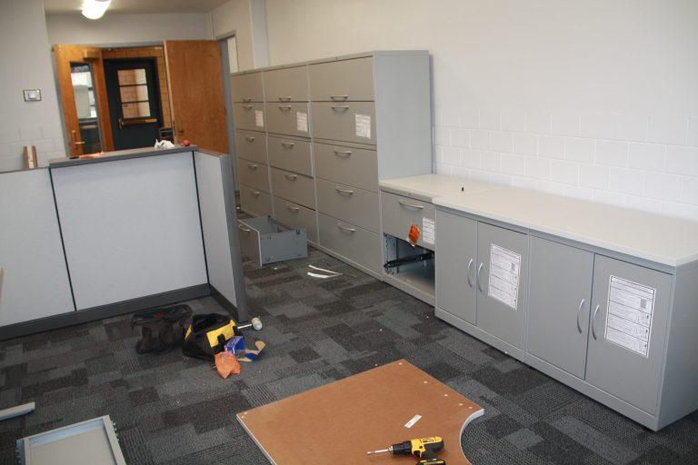 Furniture installation in progress.
