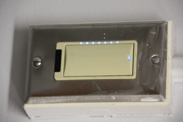 Motion-activated light switch with dimmer and auto shutoff. The room is much brighter!