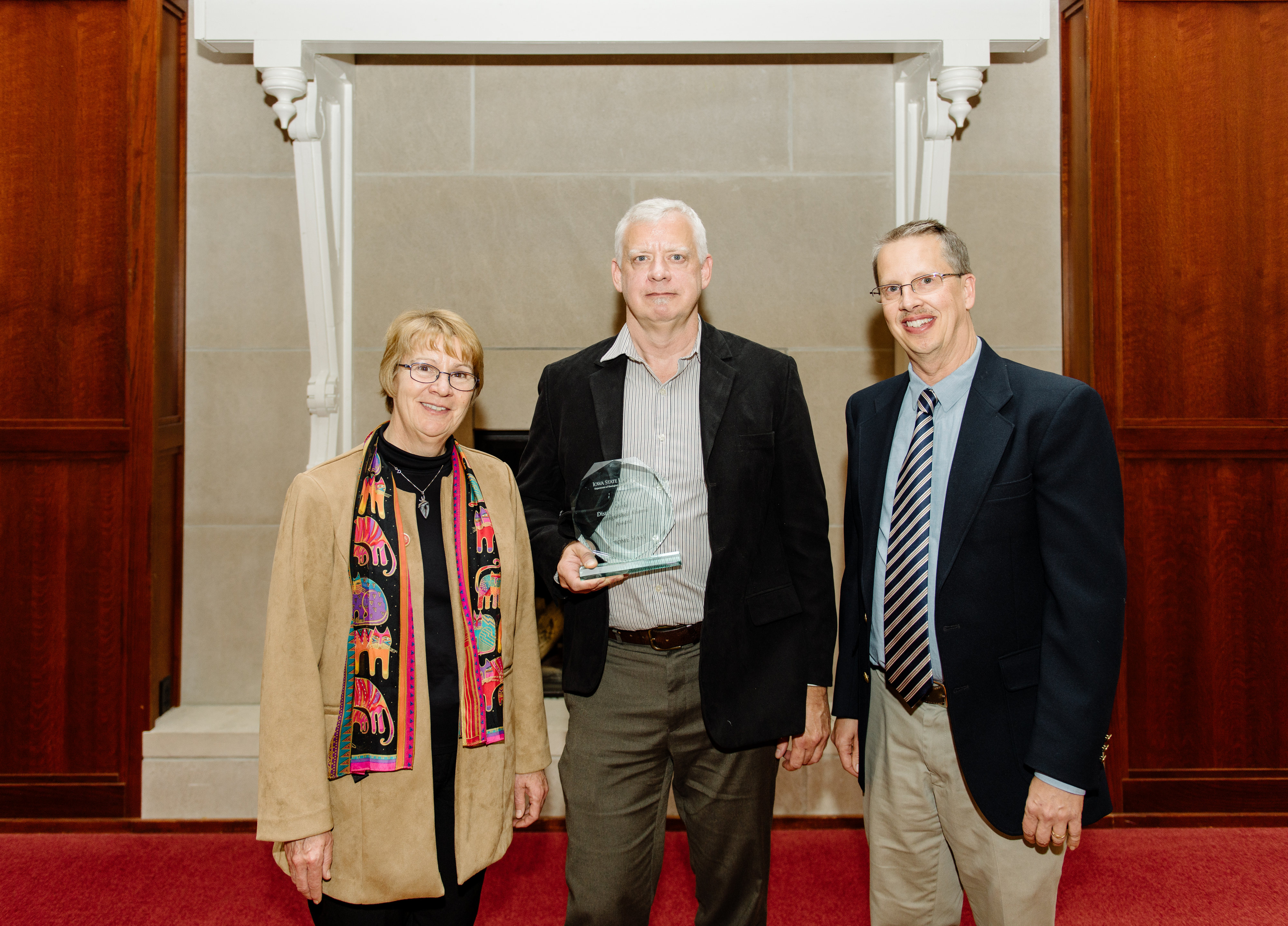 Jerome Fast (center) stands with Dean Schmittmann (left) and Bill Gallus (right) after receiving the GEAT Distinguished Alumni Award