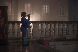 Destiny Esaw prepares to move to a new location during a night photography session on the streets of Urbino. Photo by Dennis Chamberlin