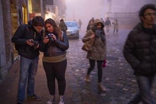 Jared Gorton and Jessica Darland check their images during a night photography session on the streets of Urbino. Photo by Dennis Chamberlin