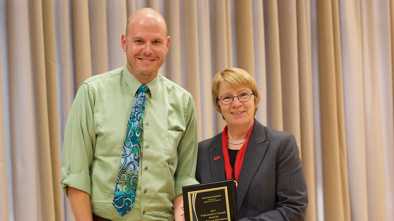 Shane Scherschel, system support specialist, and Beate Schmittmann, dean of the College of Liberal Arts and Sciences