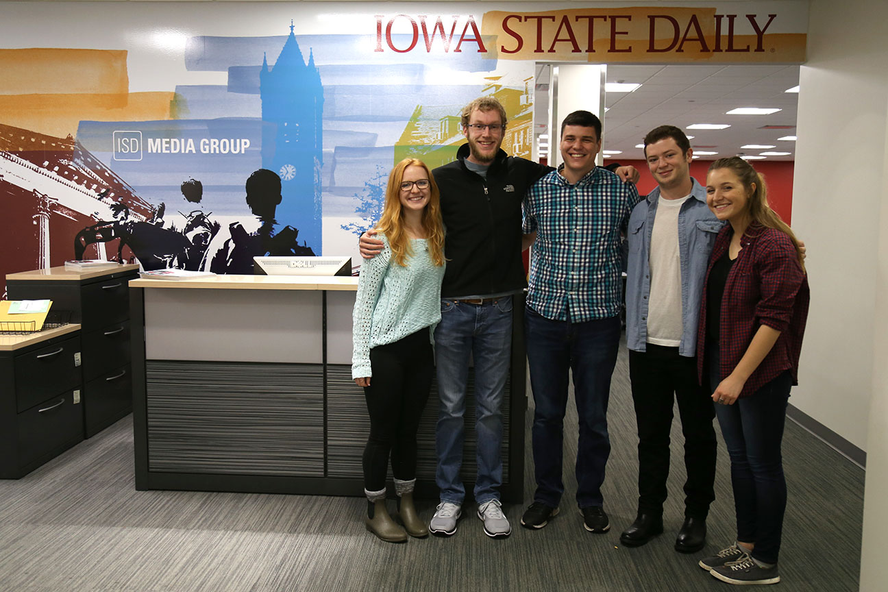 Five students, two female and three male, standing in the Iowa State Daily.
