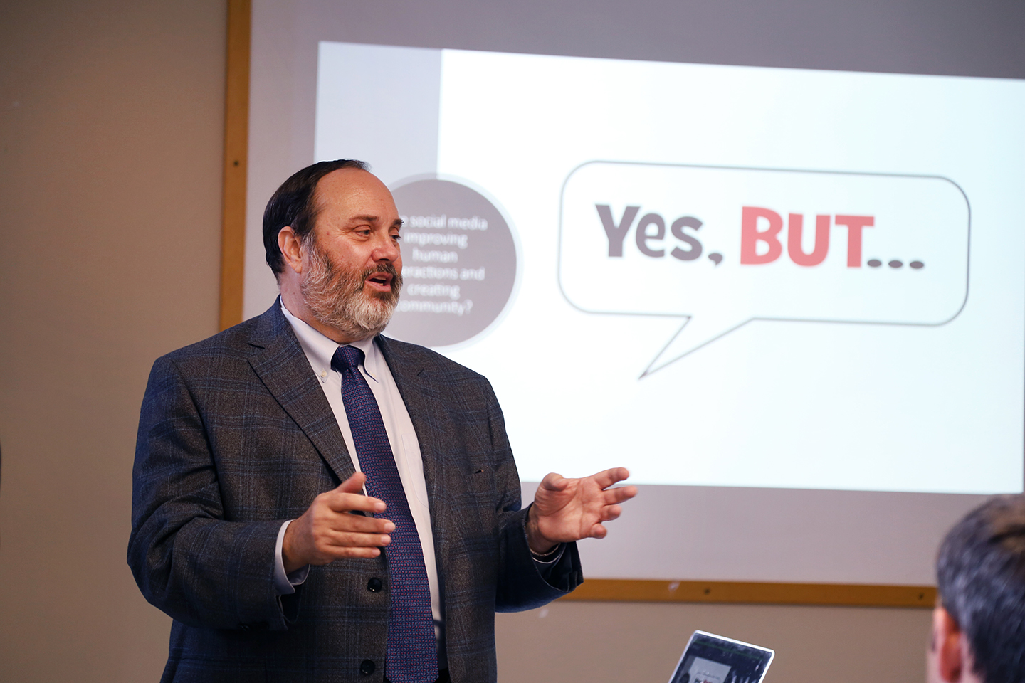 "Robert Picard presents in 172 Hamilton Hall with a Powerpoint slide on the screen that says ""Yes, But"" behind him"