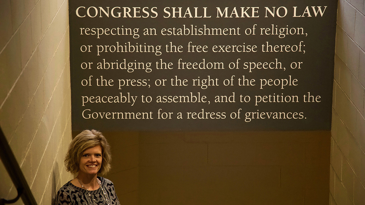 Julie Roosa pictured with the text of the First Amendment