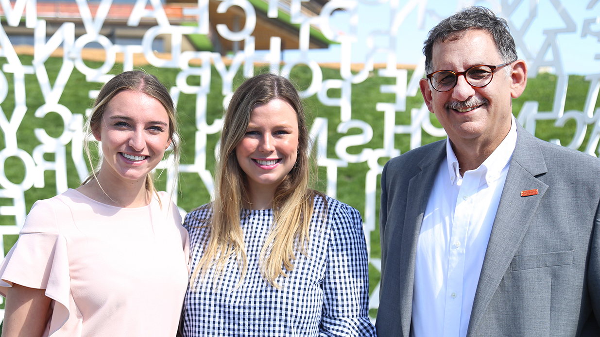 Associate Professor Jay Newell, right, has helped prepare Greenlee students, including Lindsey Moor, left, and Ashley Kirkpatrick, center, for the Washington Media Scholars Case Competition.