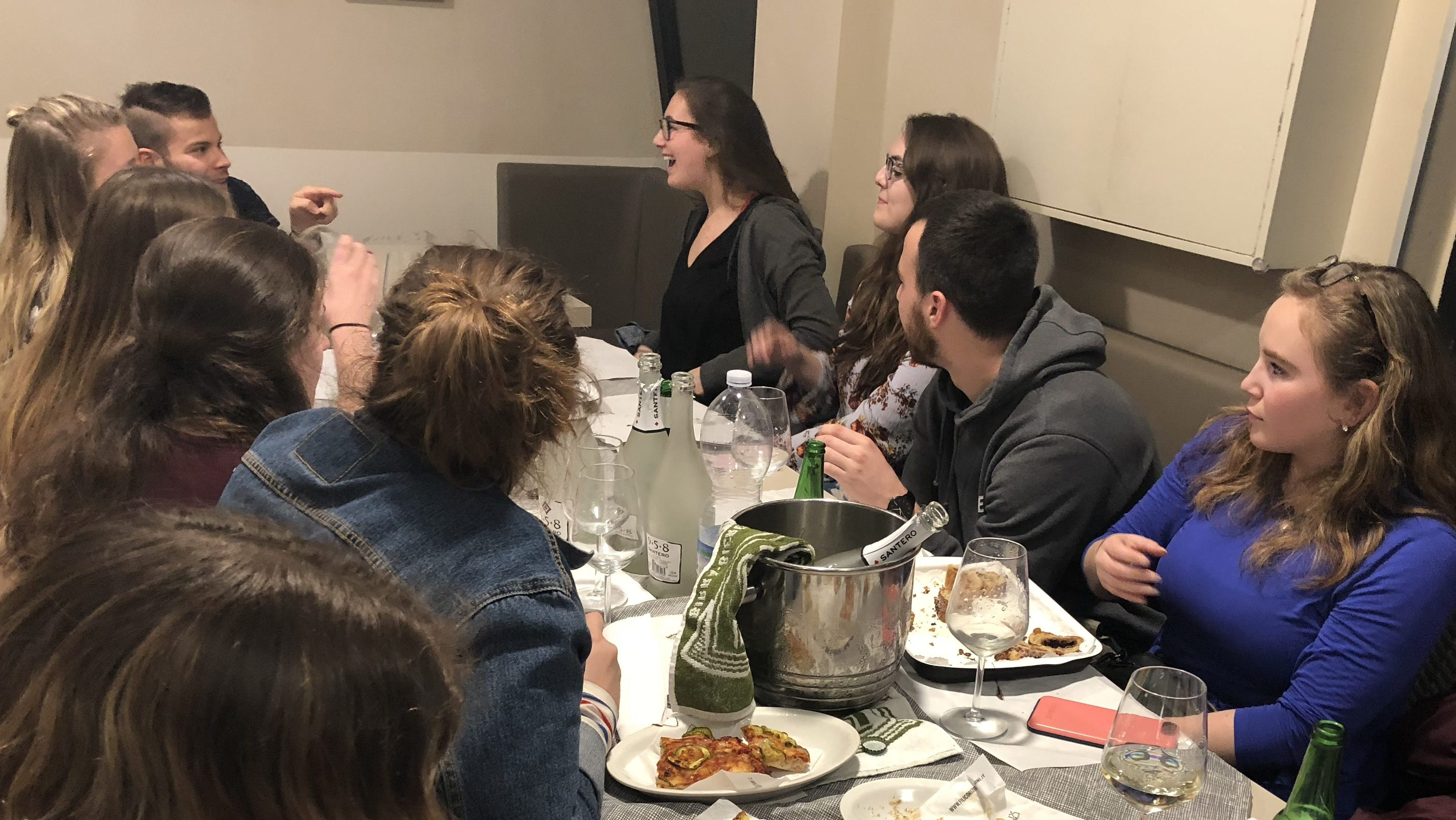 Urbino study abroad students enjoy a selection of aperitivo foods at Café Sugar on Mar. 28. Photo by Katlyn Campbell