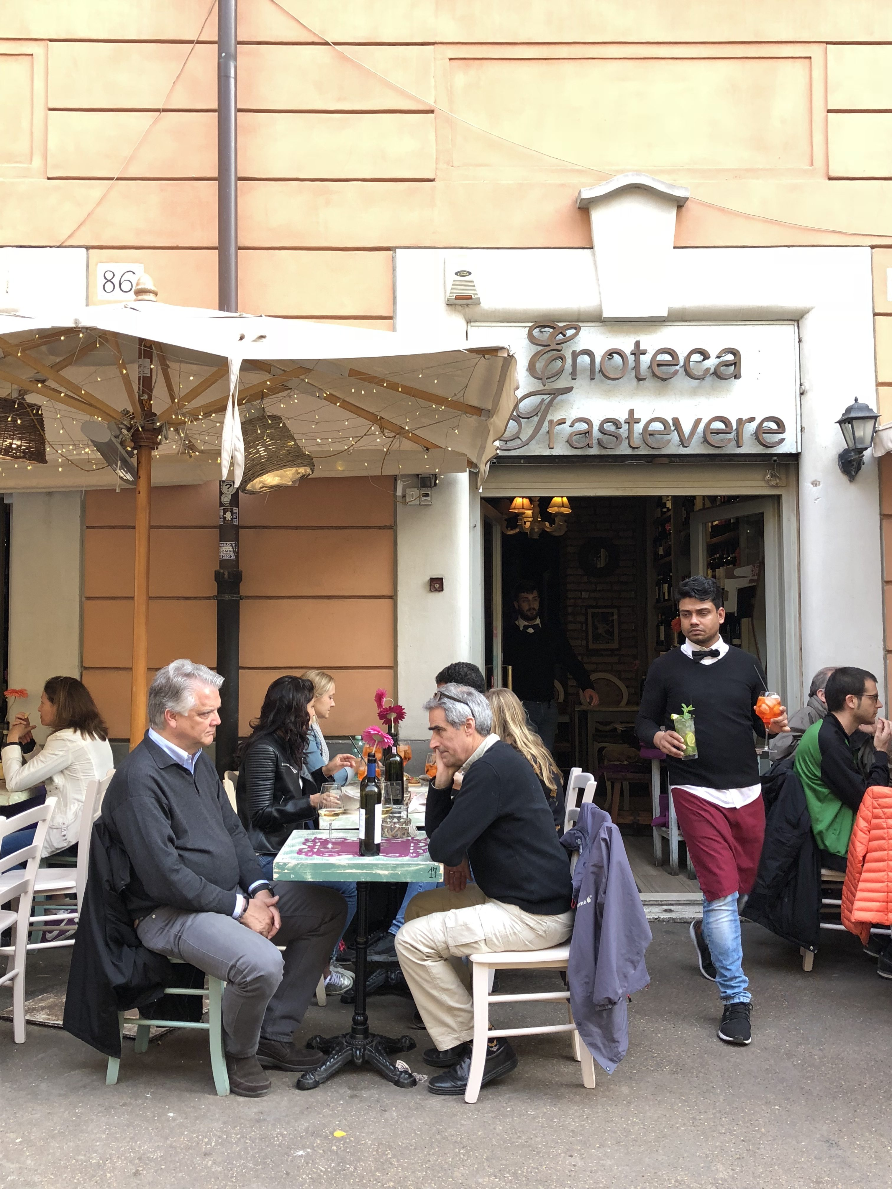 People participate in aperitivo at Enoteca Trastevere on Apr. 15. Photo by Katlyn Campbell