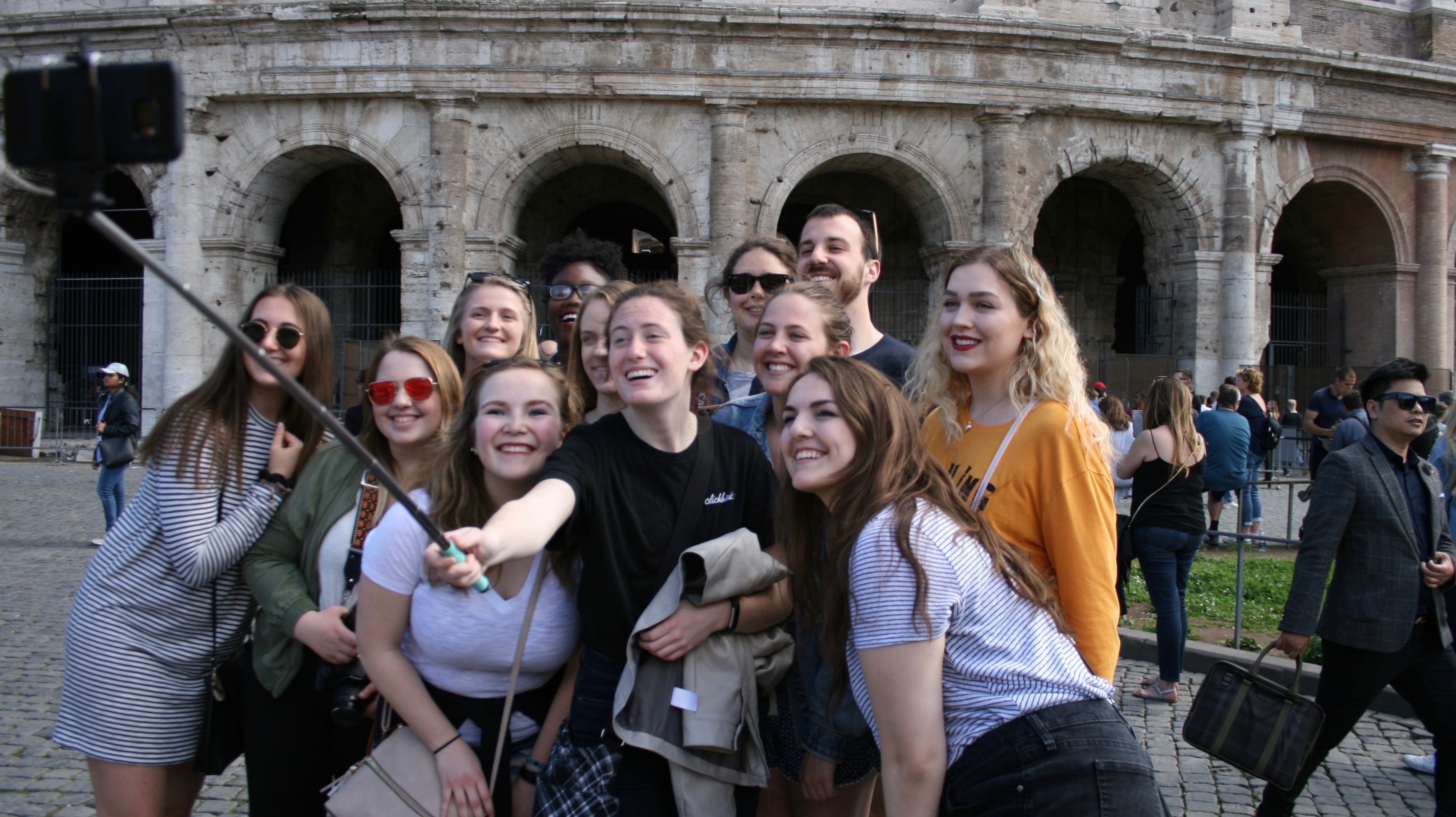 Our group takes a selfie in front of the Coliseum in Rome. Photo by Dennis Chamberlin