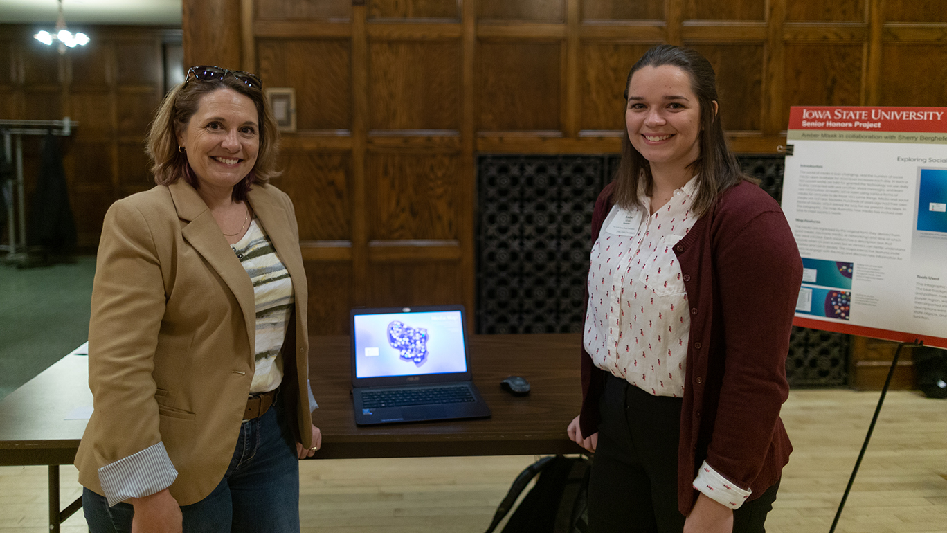 Greenlee Senior Lecturer Sherry Berghefer, left, and Amber Misek, graduating senior in public relations and psychology, at the Fall 2018 Honors Poster Presentation. Photo by Gabe Altier