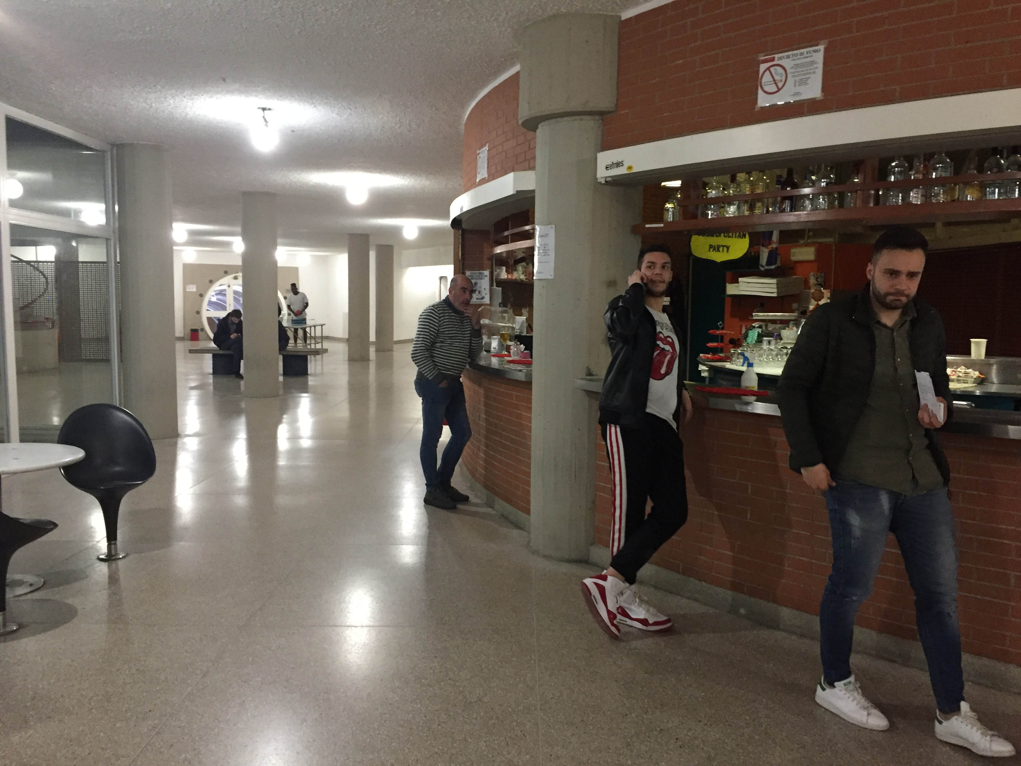 The bar outside the Mensa (cafeteria) is a wide social place where students can be found hanging out before and after meals. Photo by Bridget Hepworth