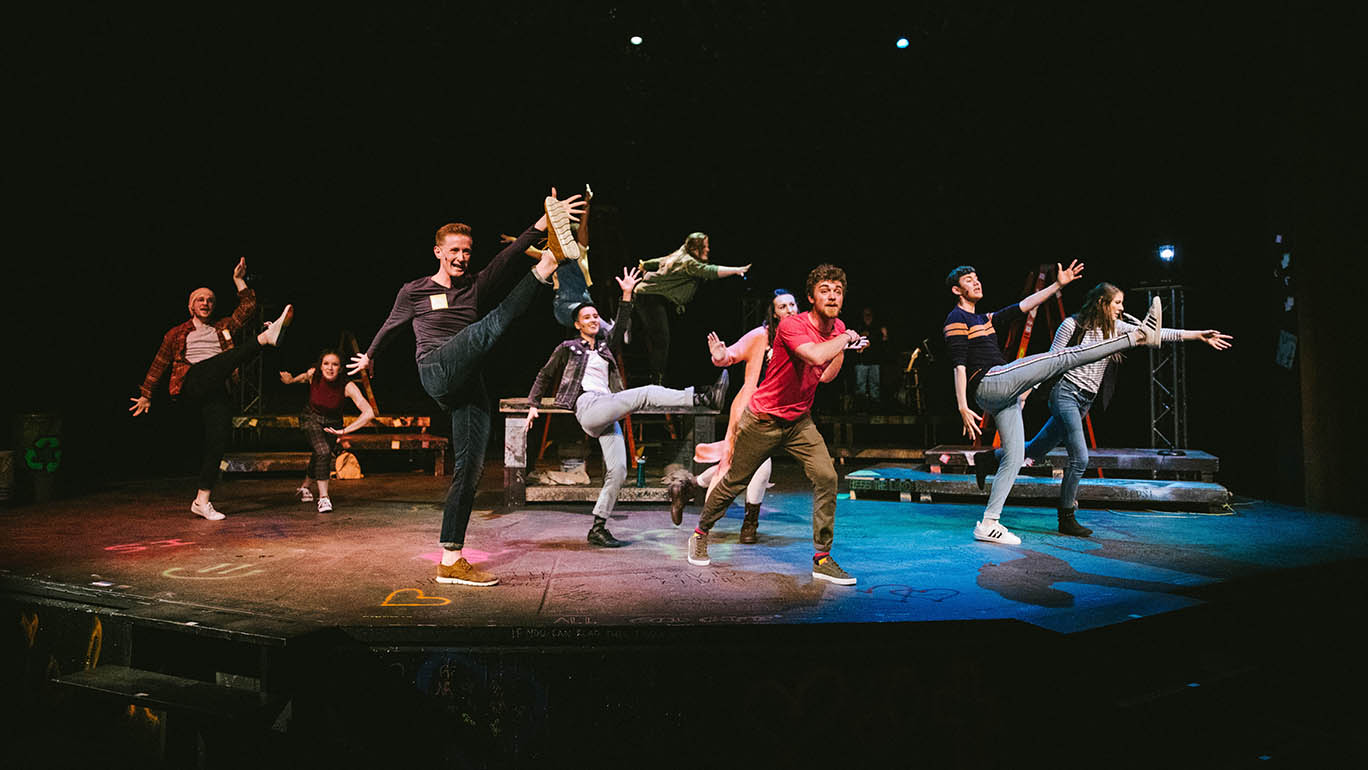 Keaton Lane (front left) and the cast of Godspell. Photo courtesy of the Iowa State University Department of Music and Theatre.