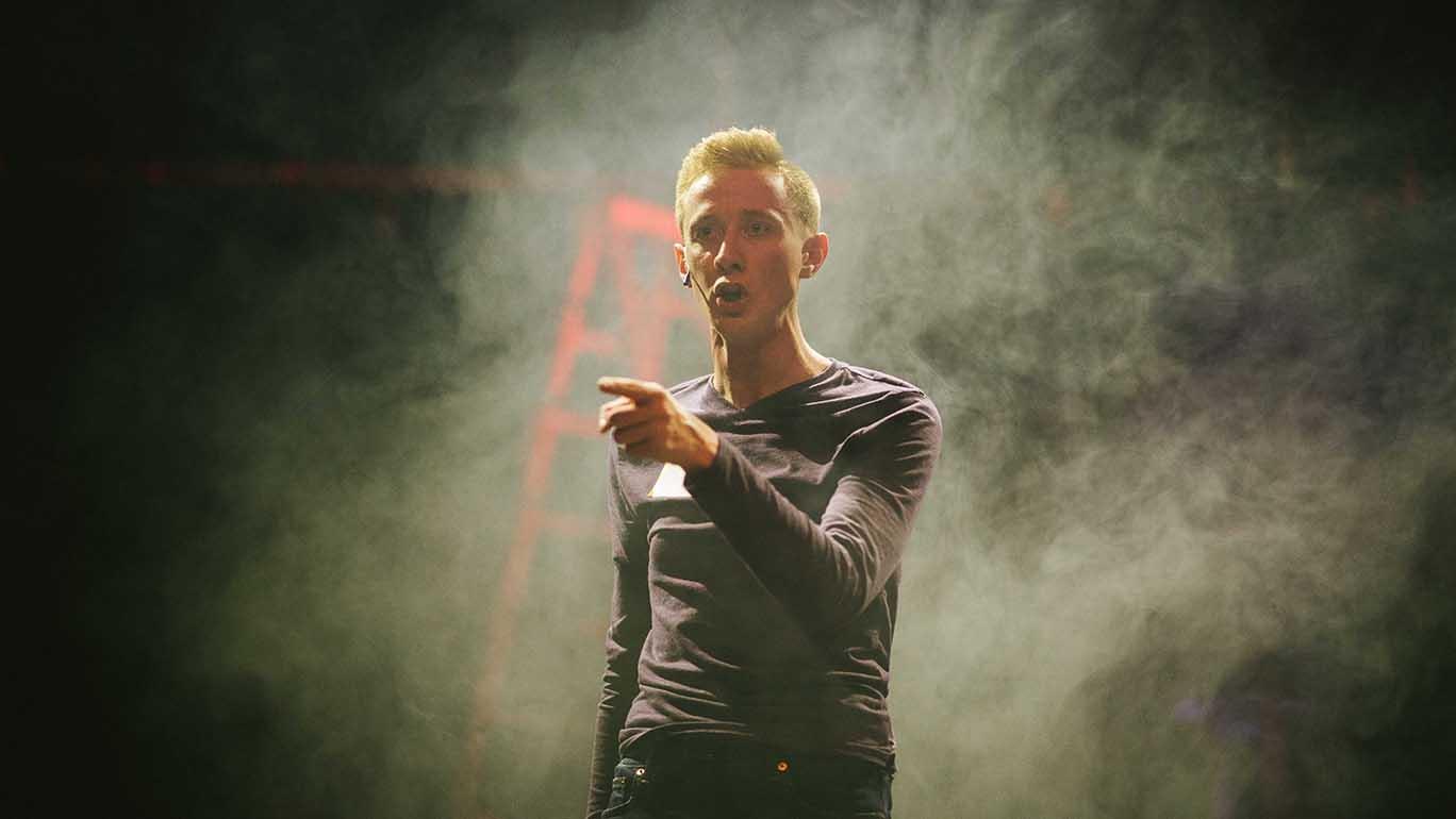 Keaton Lane performing in Godspell