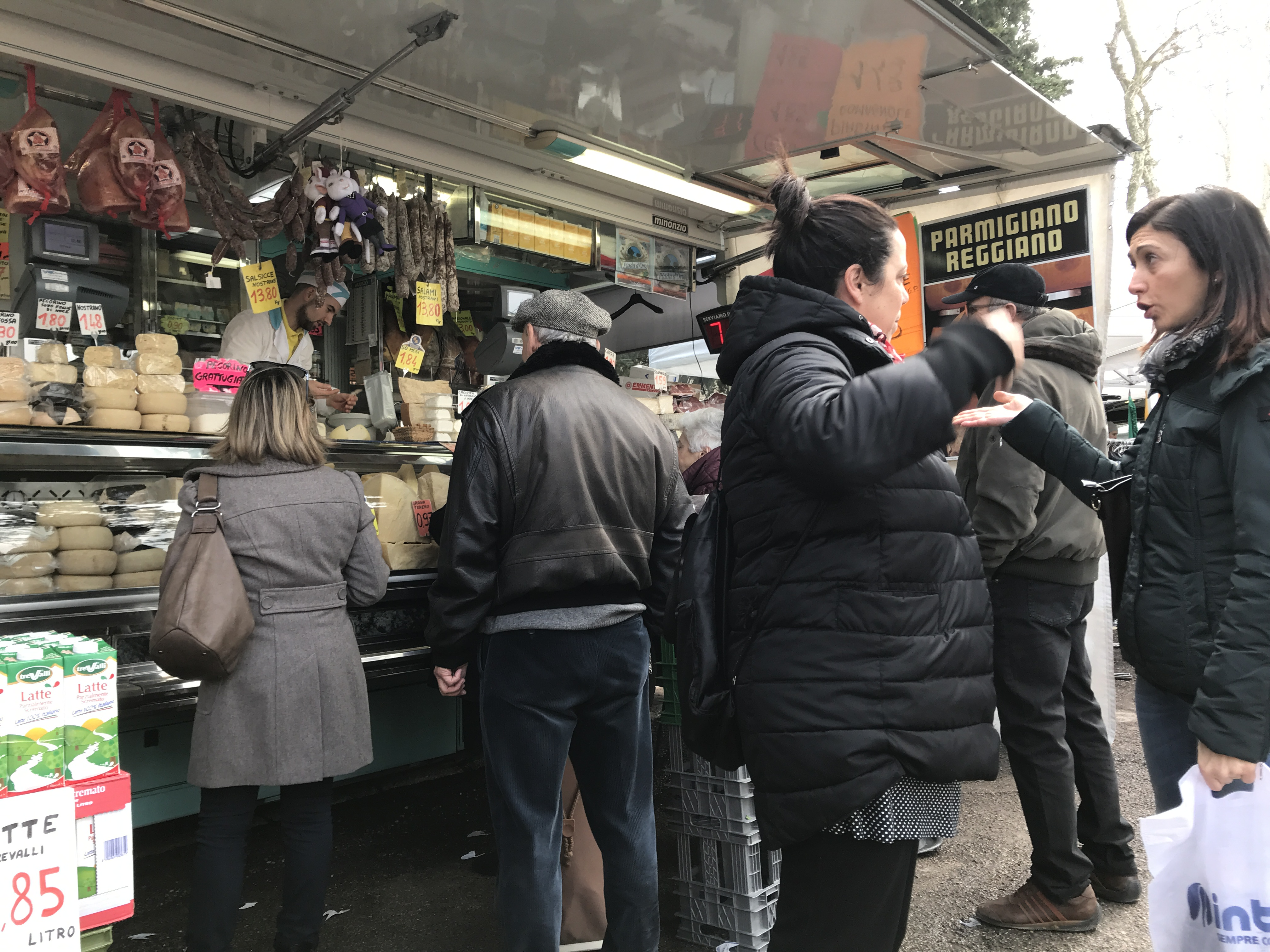 Waiting in line in the market is a social event where many people catch up with one another. Photo by Ryan Bedford.