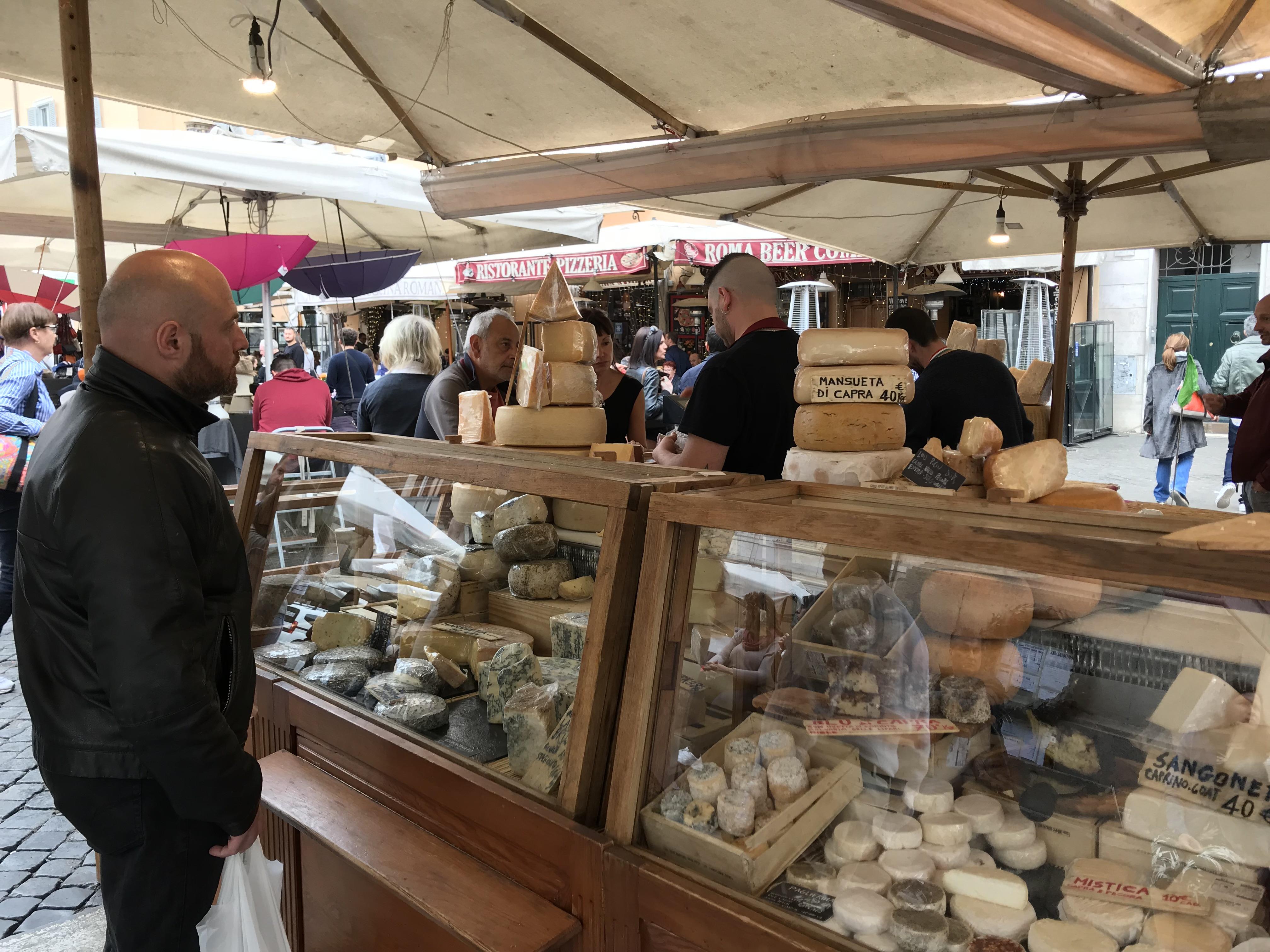 A cheese vendor during the Sunday market in Campo Di Fiori in Roma. Photo by Ryan Bedford.