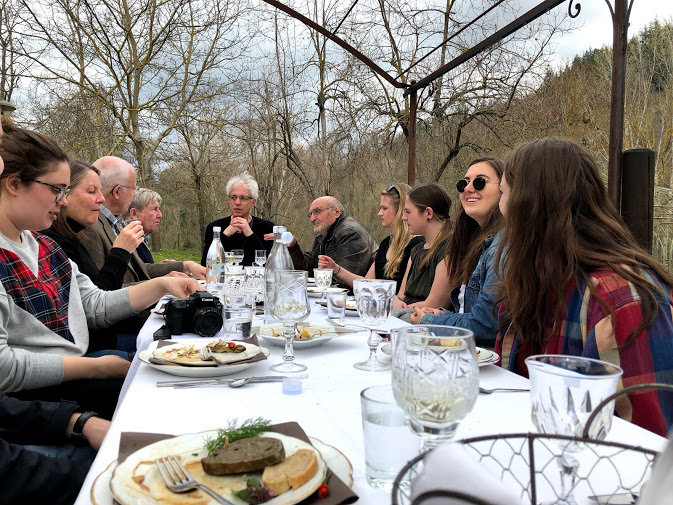 Greenlee students, professors and guests dine together at Casa Tintoria. This restaurant in Urbania, Italy, was the subject of a photoshoot for students on March, 29, 2018. The main goal was to capture photos for an assignment, but many students enjoyed the overall atmosphere at the restaurant. Photo by Grace Ekema