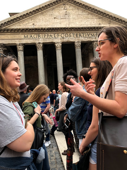Greenlee students spent a weekend in Rome and attended many class sessions there, including one outside the Pantheon on April 15, 2018. Here, Professor Marilena Luzietti, right, is explaining different aspects of the Pantheon to student Gillian Holte. Photo by Grace Ekema