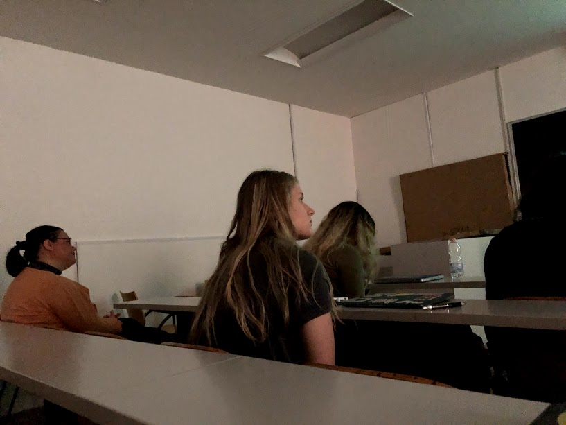 "On April 17, 2018, Greenlee students had a four-hour class period for their political thought course, so Professor Raffaella Santi showed the movie ""Hamlet.""  In the picture, Professor Santi and student Bridget Hepworth are seen watching the film in one of the classrooms at the Universita Degli Studi Di Urbino Carlo Bo. Photo by Grace Ekema"