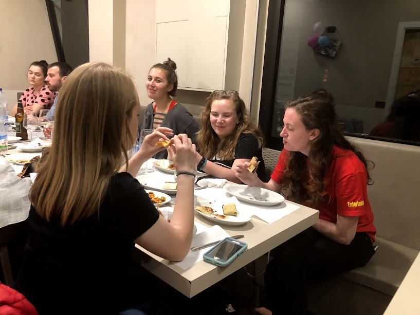 Greenlee students, including Grace Ekema, enjoy their supper at Sugar Café in Urbino. Giovanni Garbugli, the owner of the café, made students a home-cooked meal in his café, and the students are seen enjoying the dessert portion. Photo by Krishaun Burns