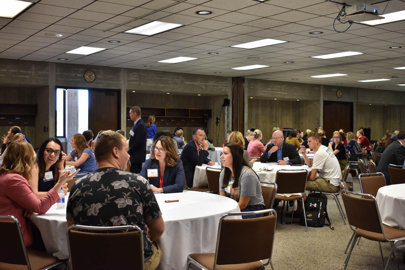 Greenlee Summit participants sit around tables