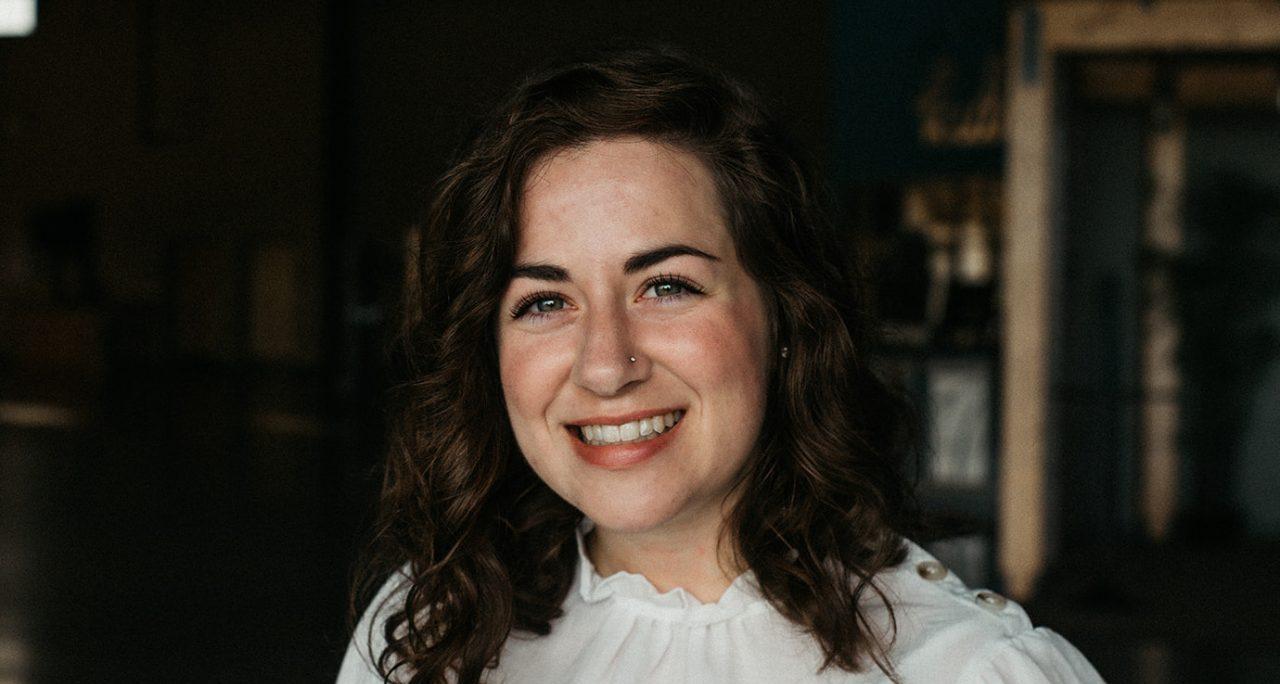girl smiling against dark background