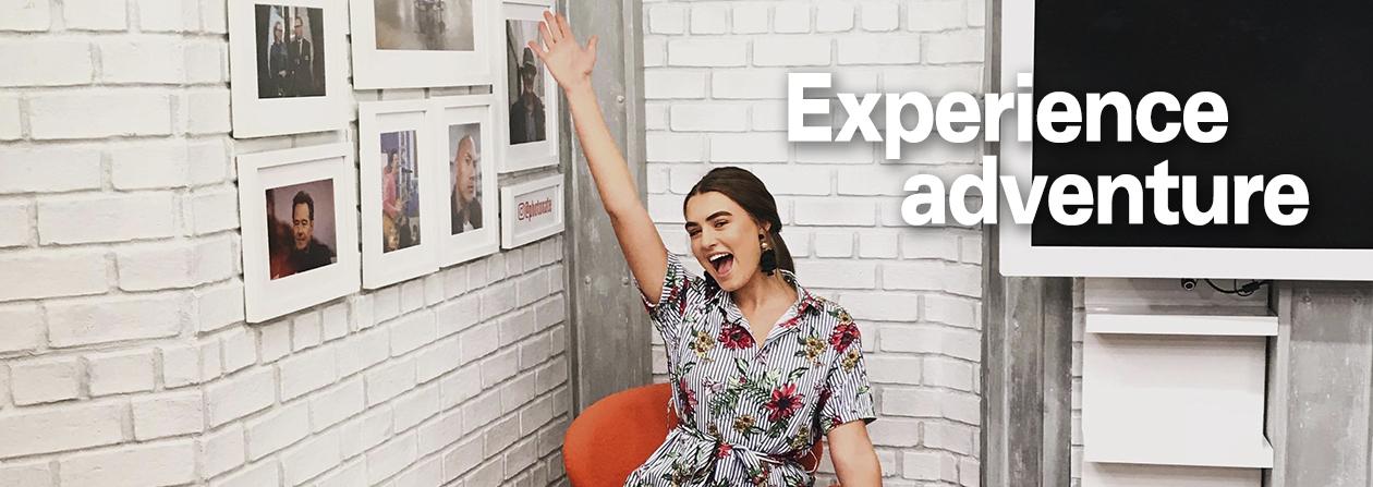 a woman raises her hand at her internship
