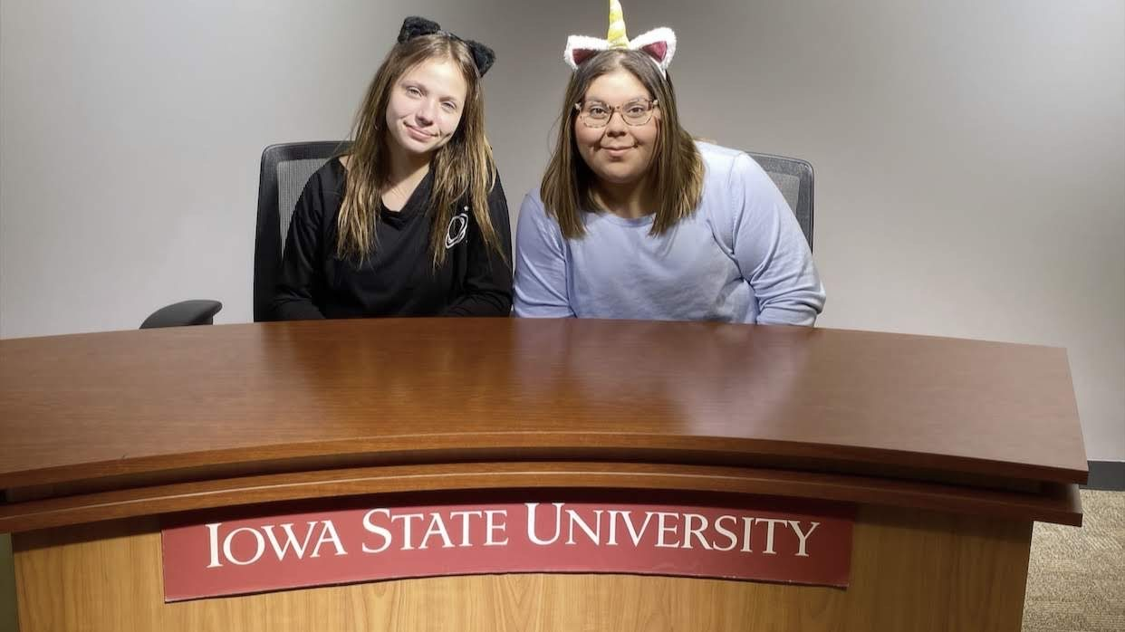Loretta and Cinthia behind the news desk