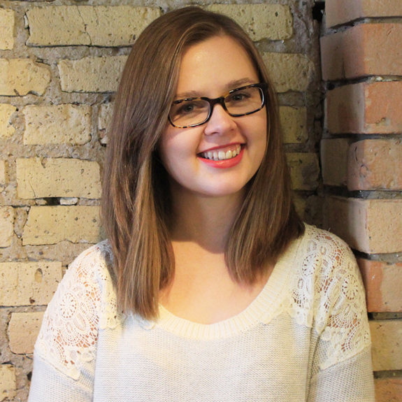 Megan Schuller smiles for the camera. She is wearing glasses and has brown hair.