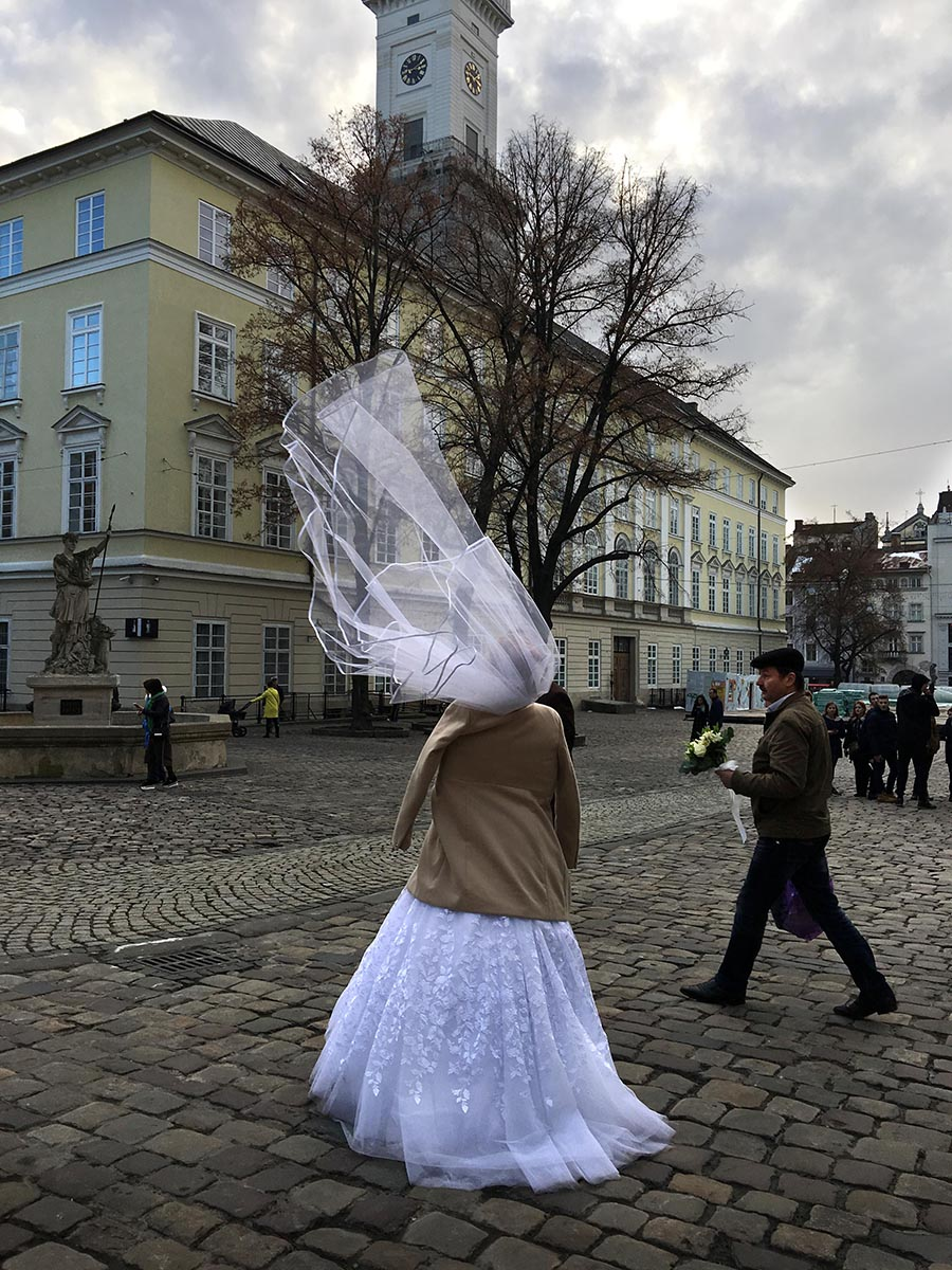 While waiting for a workshop to begin, Associate Professor Dennis Chamberlin captured a photo of a bride walking through Lviv Town Square. Photo by Dennis Chamberlin