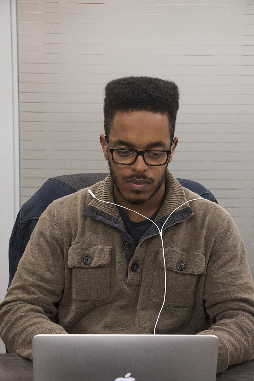 The Iowa State Daily has students from many Iowa State University colleges on its staff. Dawit Tilahun, a junior in finance, worked as reporter covering the College of Business. Photo by Emily Blobaum