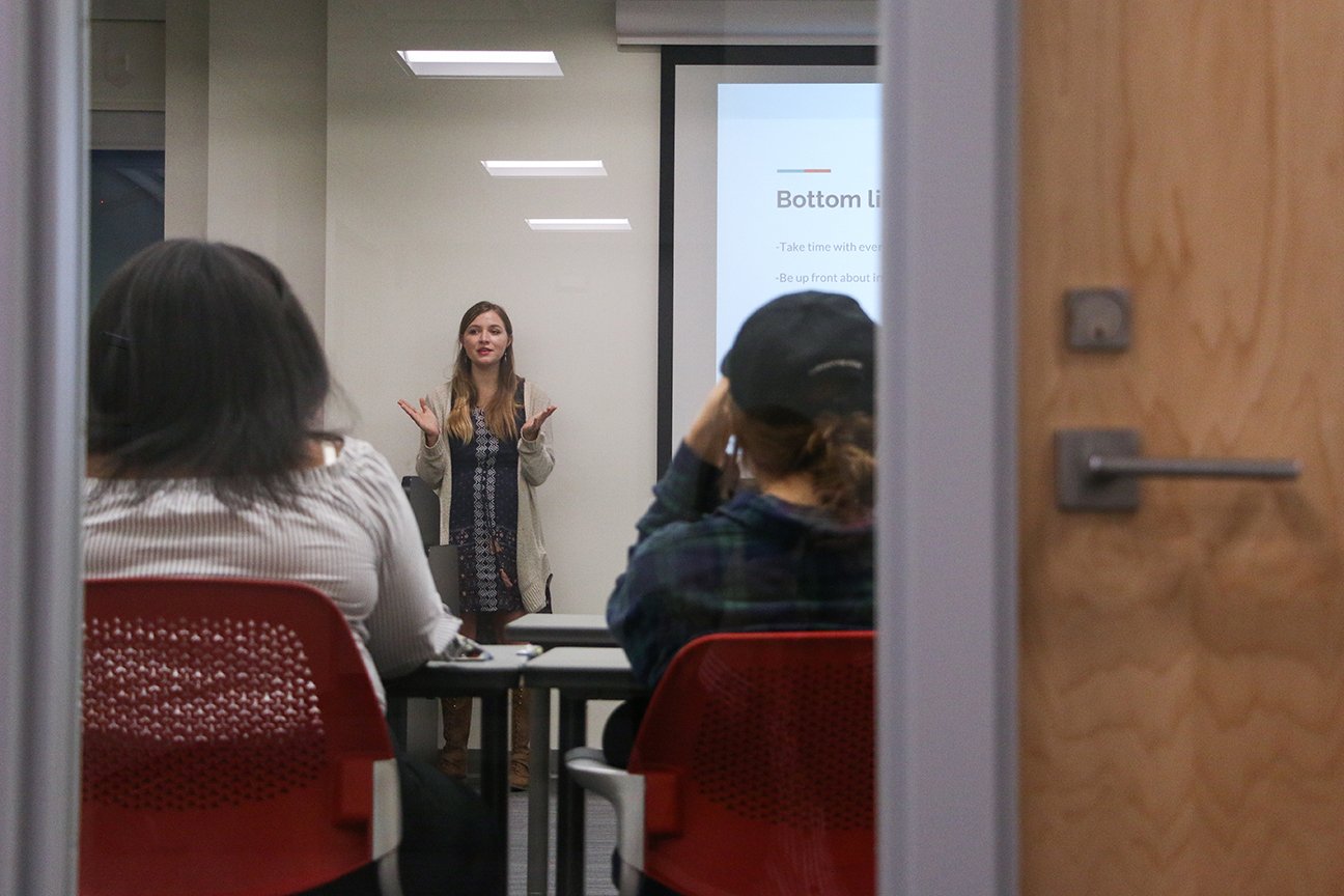 News Editor Danielle Gehr, junior in journalism and mass communication, shares insights with reporters at a staff meeting. Photo by Emily Blobaum