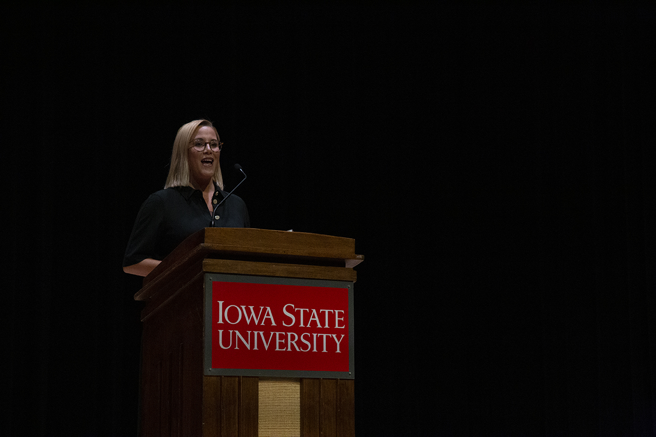 S.E. Cupp standing at a podium